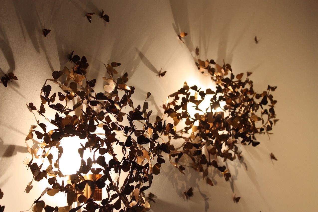 Hundreds of individually crafted brass moths make up these lighting fixtures. Actually, Limited moths is part of the RealLimited series, which points out limitations in reality. The design is a portrait of the moth species Catcall converse, which is highly endangered in Austria.