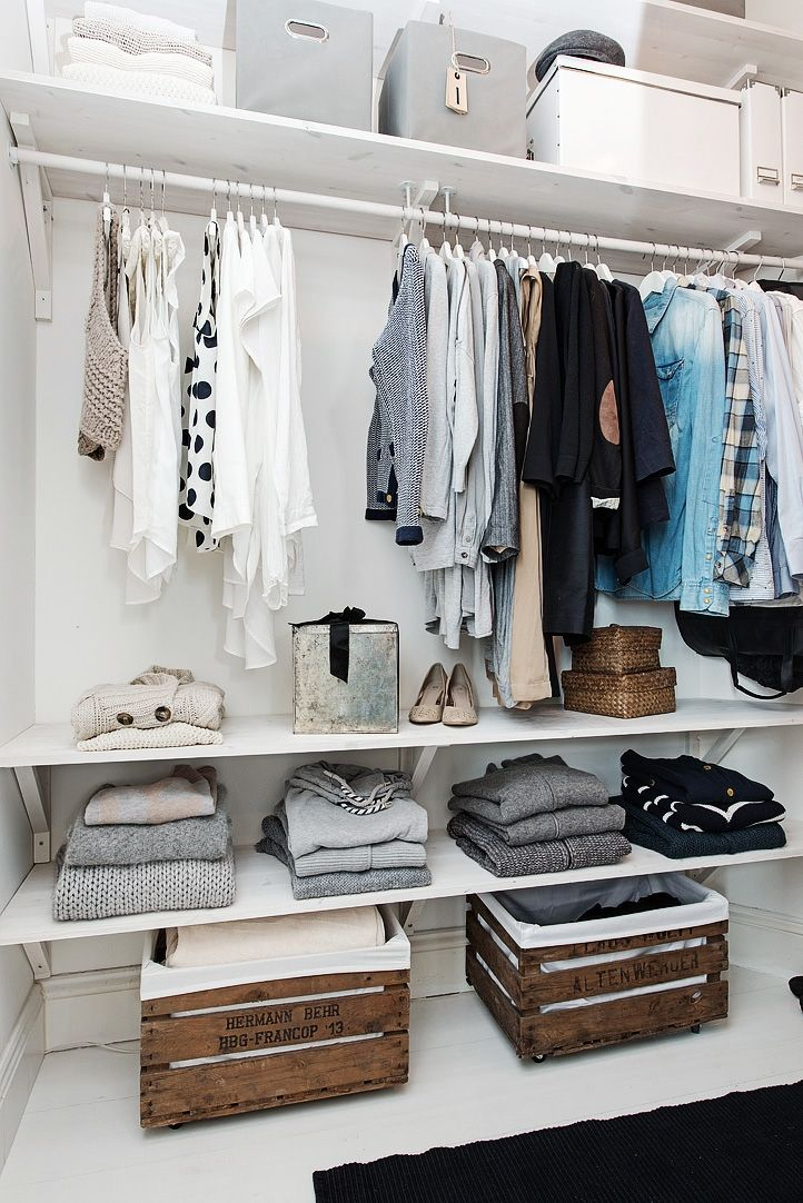 Walk in closet with wood crates