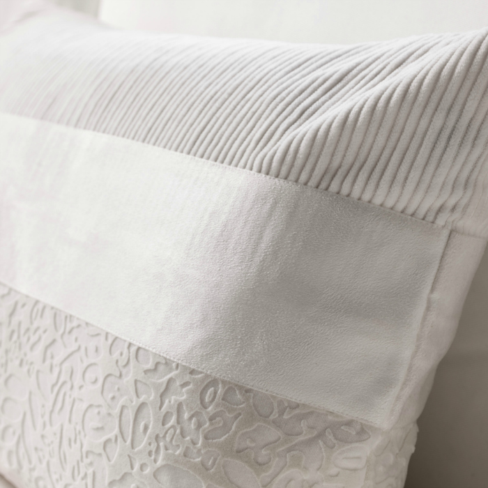 White patterned throw pillow