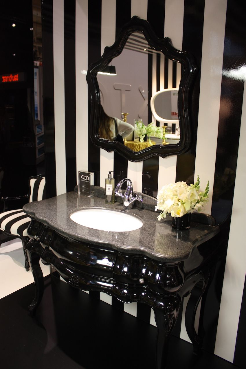 This shiny and elegant black single vanity from Godi is perfect for black and white bathroom. The gray marble vanity top adds to the glamorous feel of the set.