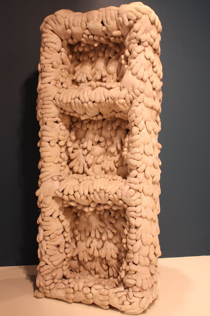 "This unusual piece was part of the Barbara Mathes Gallery's exhibit called ""Uncanny Objects. ""By using repetition, unconventional materials and by conjuring imagined worlds, these artists make known objects strange and bring intimacy to the unfamiliar,"" explains the gallery's description."