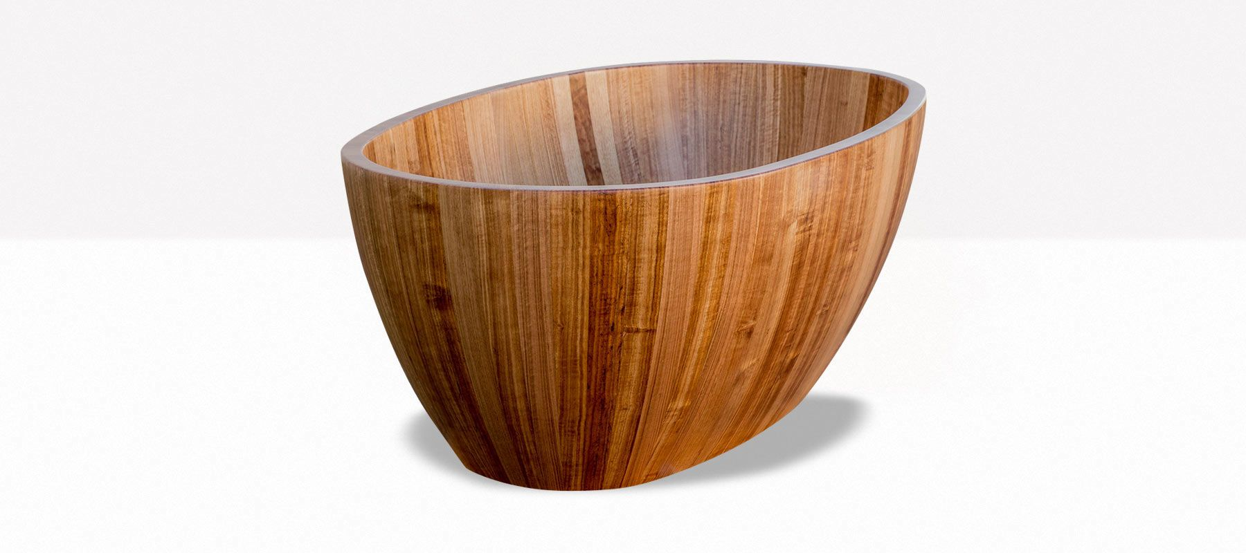 The Barrel wooden bathtub from Wood + Water is made from Tasmanian Oak and still maintains the feel of a traditional soaking tub, even though it's shape is modern.