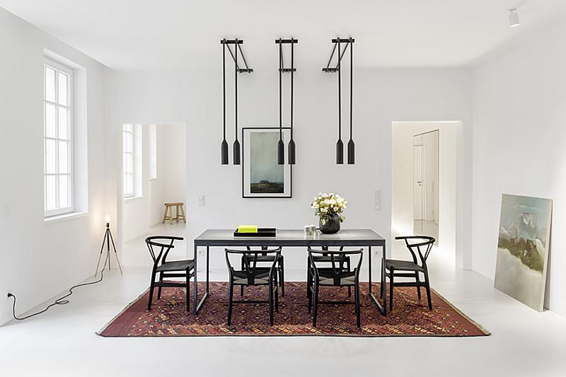 Black and white dining room with eye cathing fixtures
