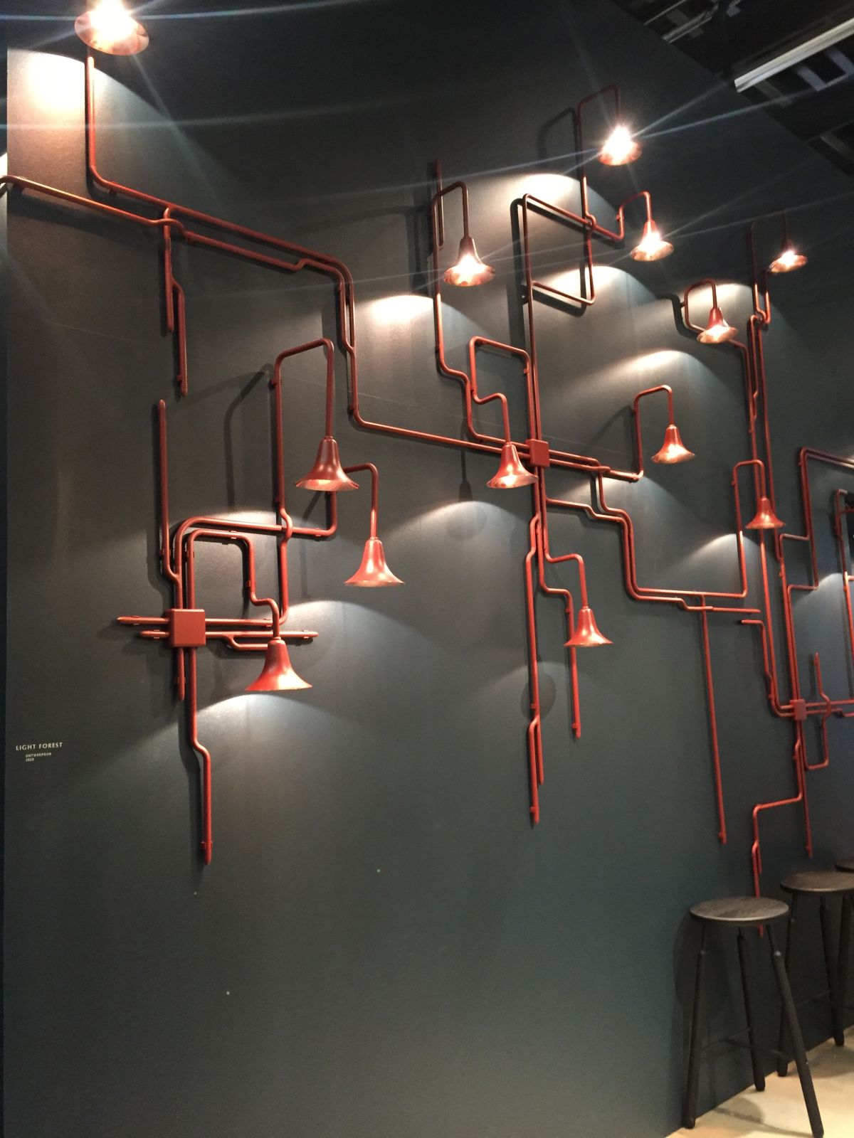 Black wall and red pipes lighting fixtures