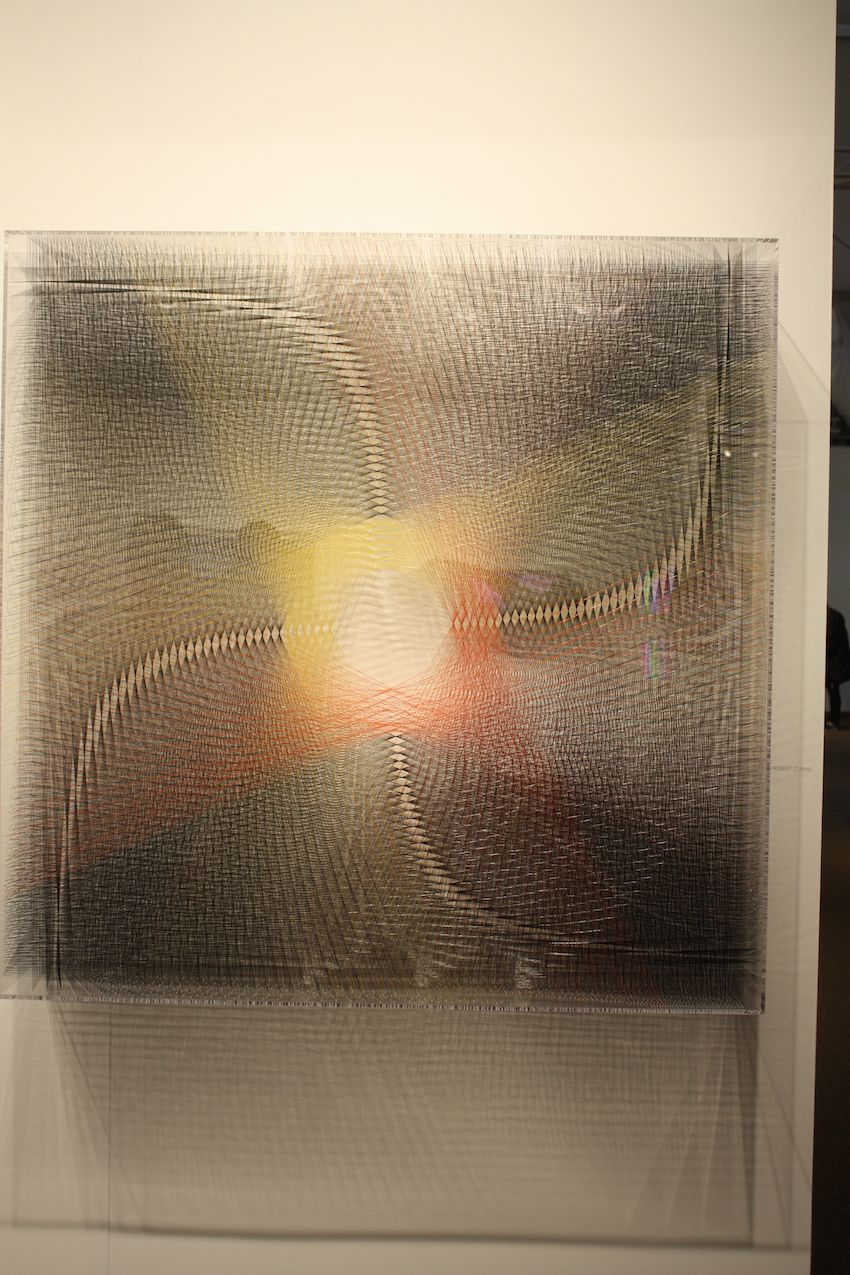 British artist Robert Currie works with synthetic materials like videotape, cassette tape and nylon to create his impressive pieces. This one, done with string, is a geometry lesson in and of itself.