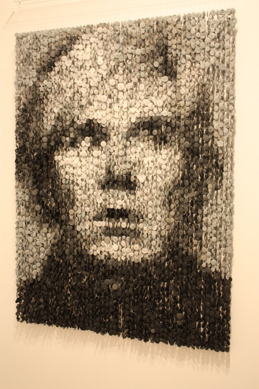 This fantastic portrait of Andy Warhol is by Augusto Esquivel. The artist uses buttons suspended on threat to create his one-of-kind works of art.