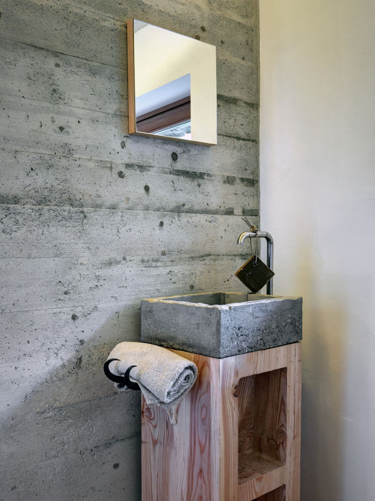 Casa Vi concrete bathroom wall and sink with wood accents