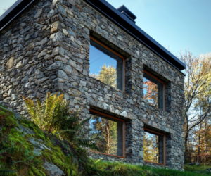 A Modern Mountain Cabin With A Rustic Stone Shell