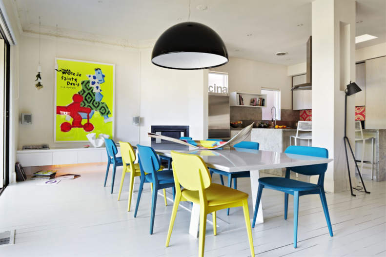 Colorful chairs for a white dining room