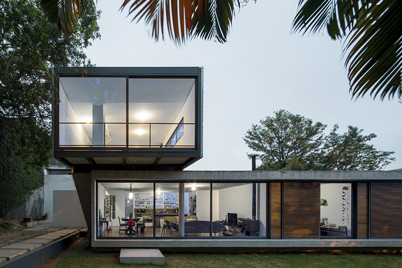 concrete and steel stacked front house by metro arquitetos associados
