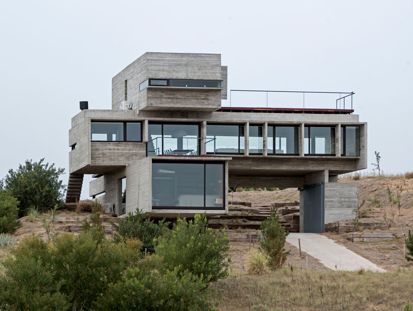 Concrete casa gold with stacked volumes front