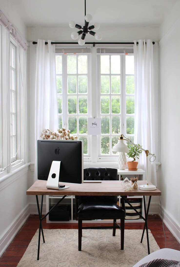 Desk placed on front of a window for natural light