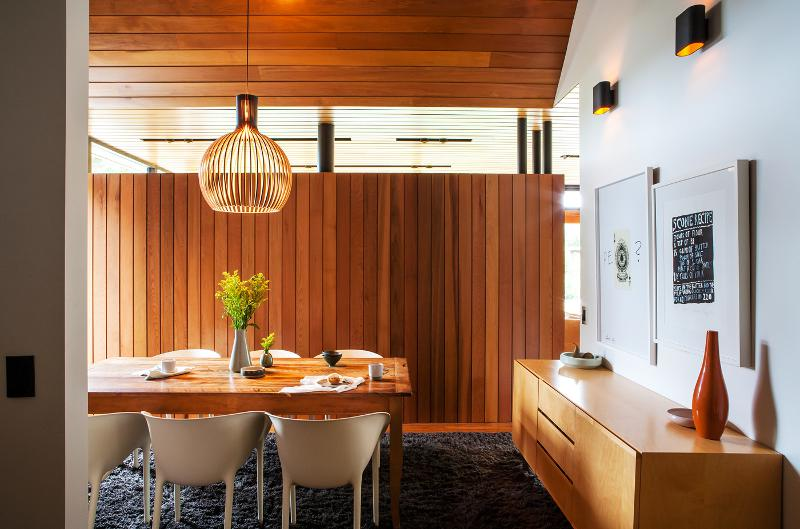 Dining room with a mid century feel and wood accents