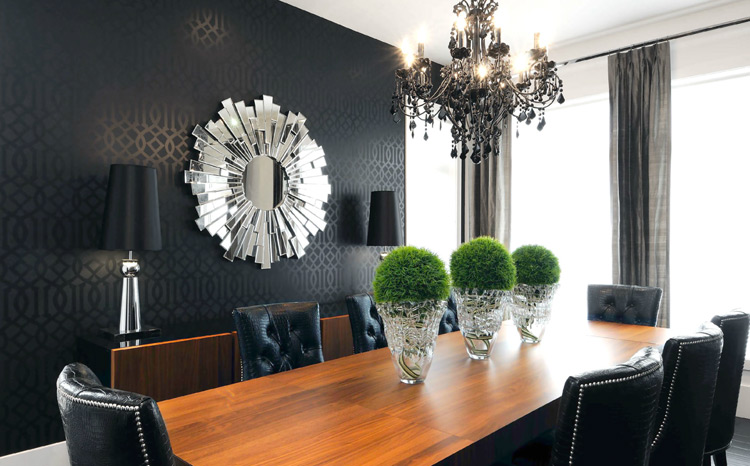 Dining room with black walls and chairs but with a touch of green