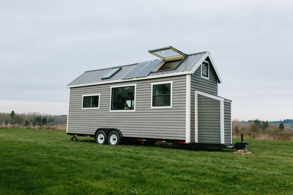 """The """"Elegant"""" tiny home on wheels has traditional exterior with many amenities inside."""