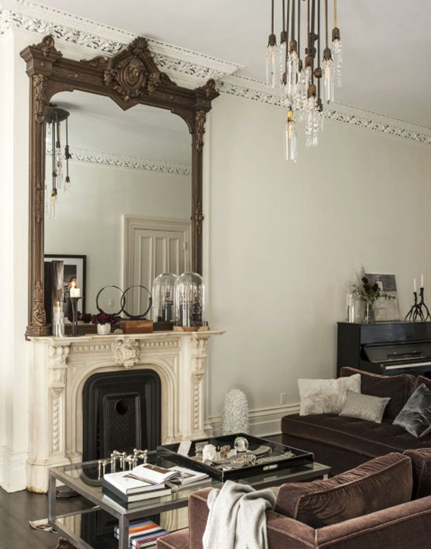 Framed mirror above fireplace