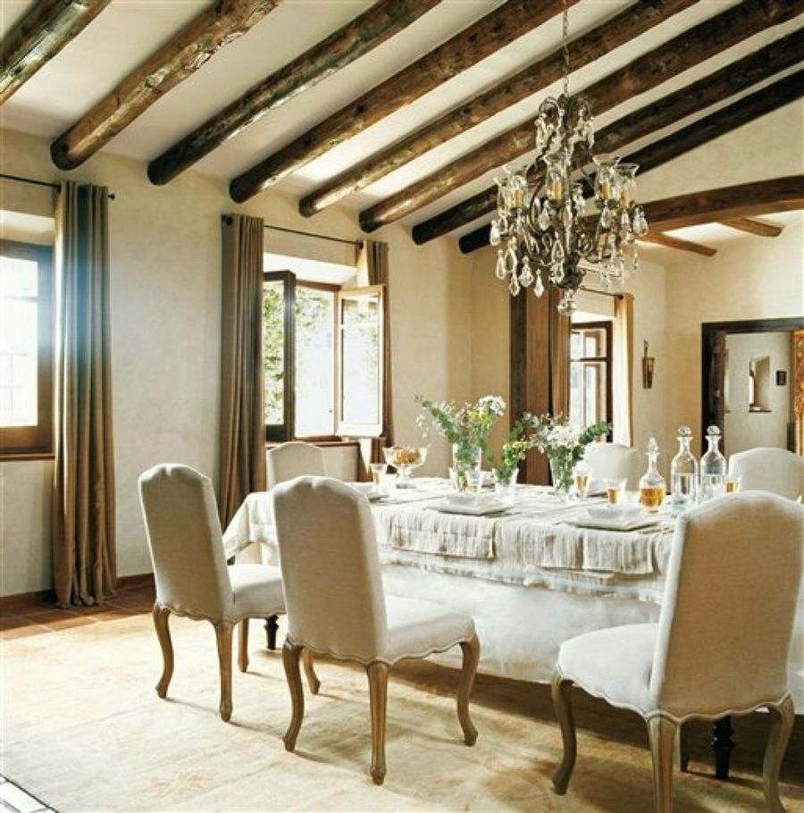 French country chandelier over dining table
