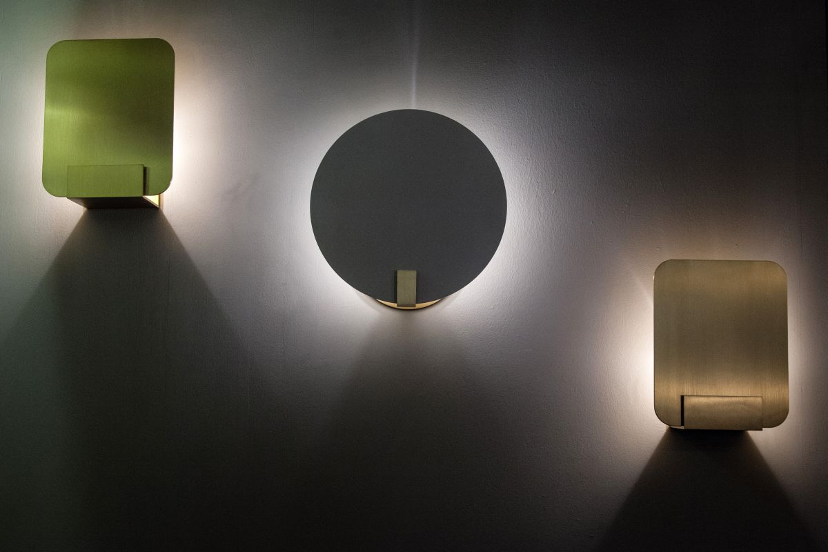 Lights bring a room from drab to dramatic geometric and spare yet dramatic these wall lights from art et floritude cast a soft arubaitofo Gallery