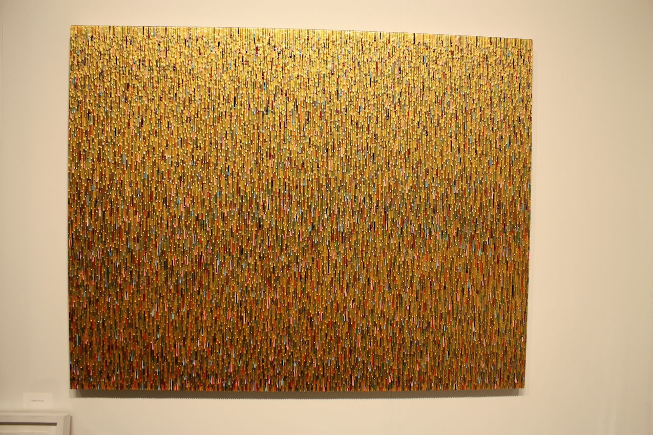 This large work also relies on precision for the thousands of gold and colored drips.