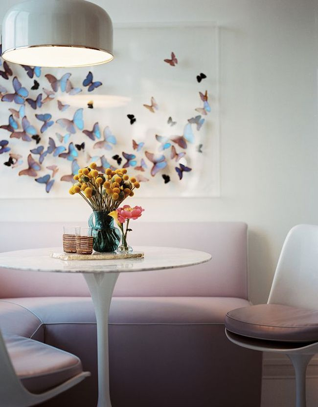 Iconing dining room furniture and butterfly wall art