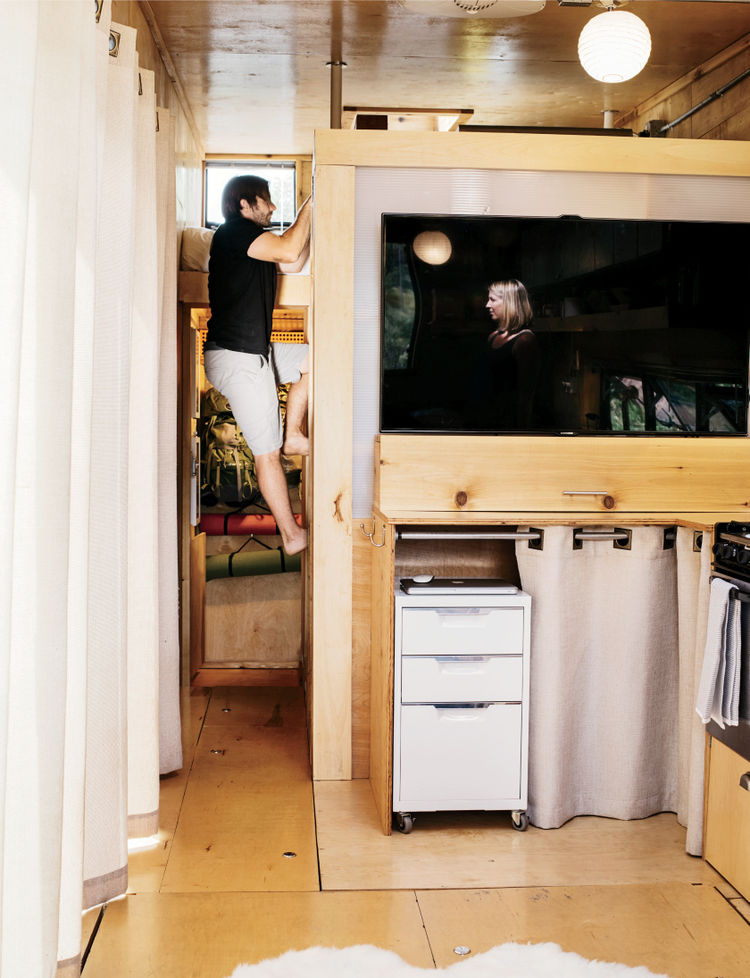 Inside mobile house in wheels - loft bed
