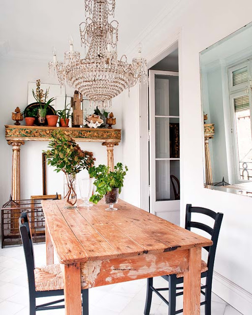 Large chandelier over farm dining table