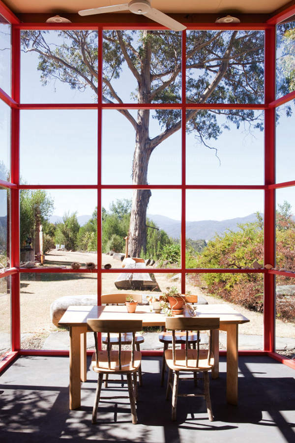 Large floor to ceiling red frame windows for dining room