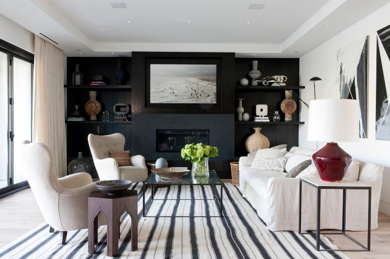 Living room with a black wall and striped carpet