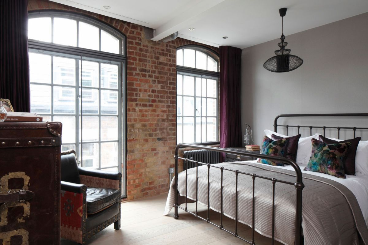 Sophisticated industrialism revealed in a london apartment for Bedroom designs new york
