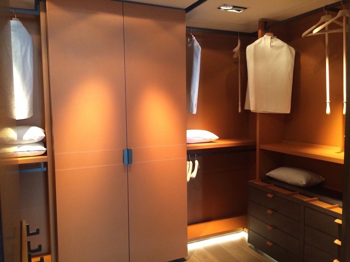Closet renovations are an example of an area where the budget can skyrocket. Adding lighting and luxe details like a leather covering in this closet doing from 4141 Design in Miami can add to the cost. The are endless options that will function as well, but don't have to be so over-the-top.