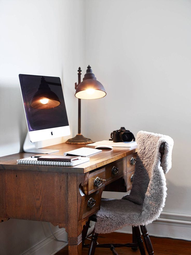 Masculine desk with a cozy chair