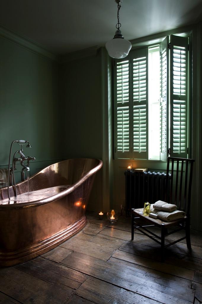 Moody green bathroom