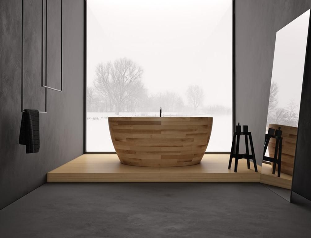 The Munai round wooden bathtub from Unique Wood Design is available in seven different types of wood and three sizes. While the choices are all beautiful, this light ash wood helps promote a serene mood.