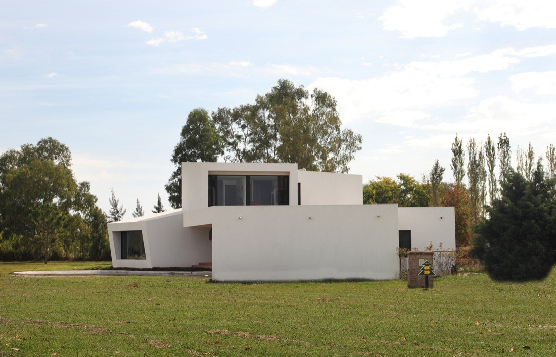 Orchid white stacked House by Andres Remy ArquitectosBack