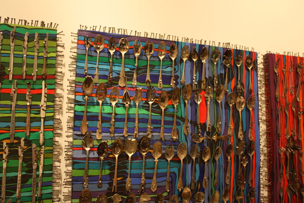 Again, ordinary objects, repetition and a jolt of color come together into stunning wall pieces.