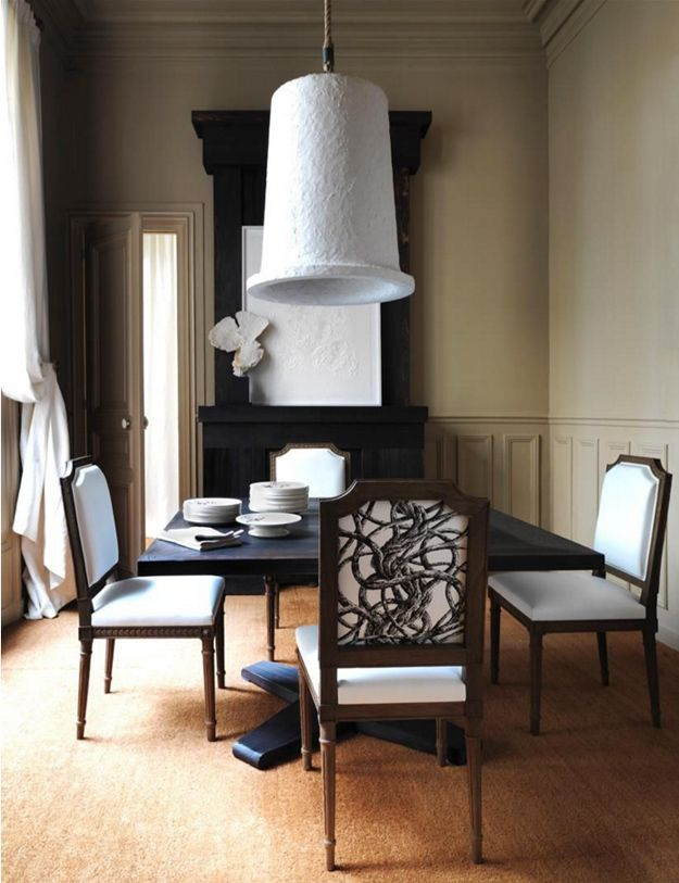 Oversized pendant lamp above the table