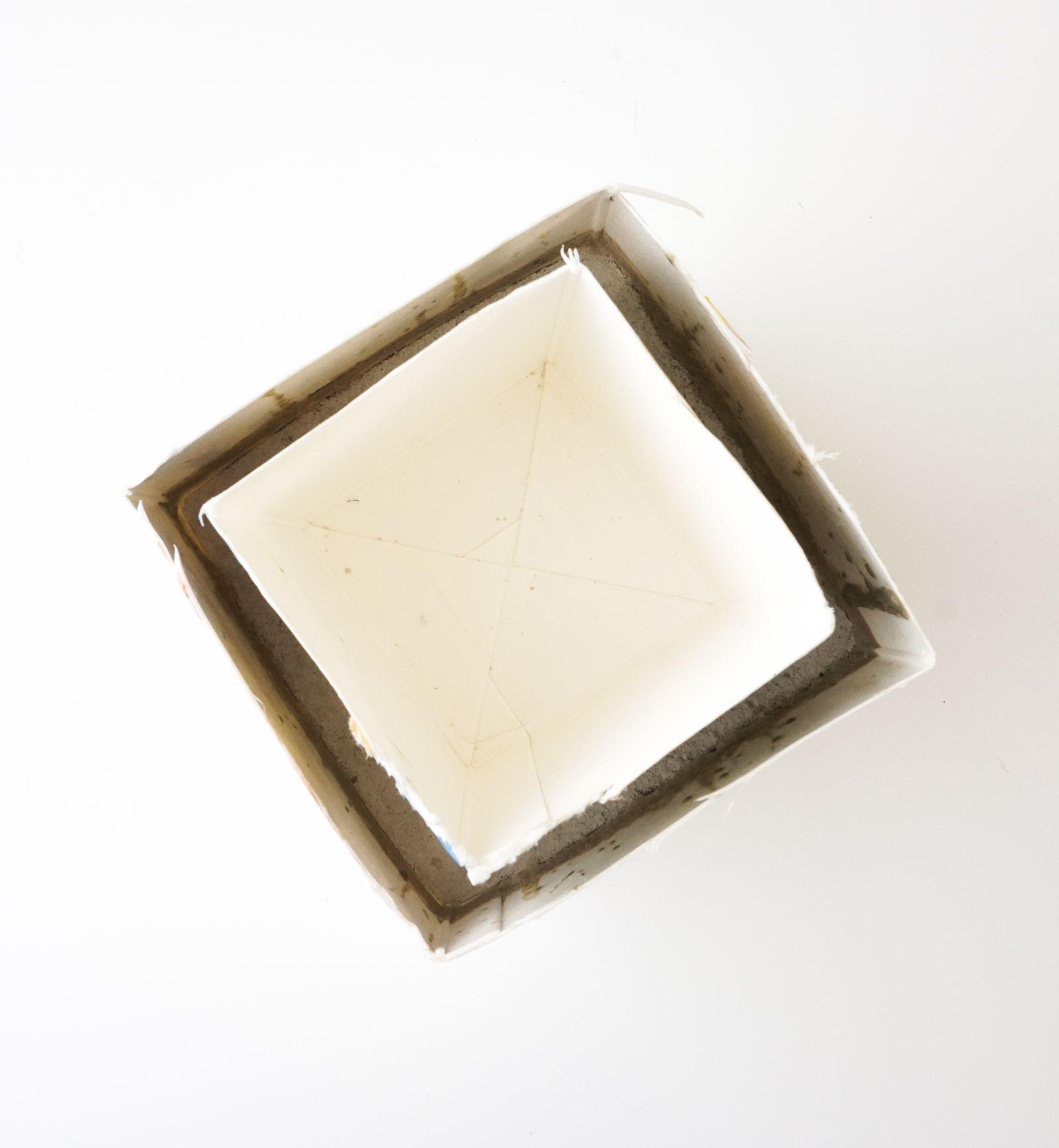 Place a smaller carton in the center