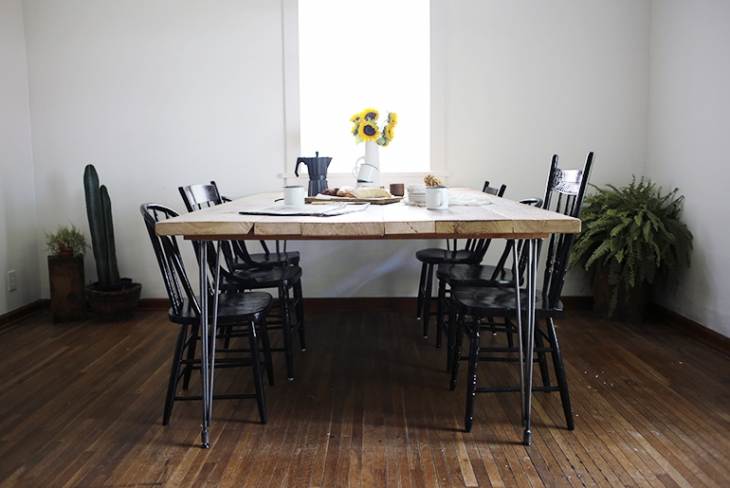 Reclaimed wood dining table with hairpin base