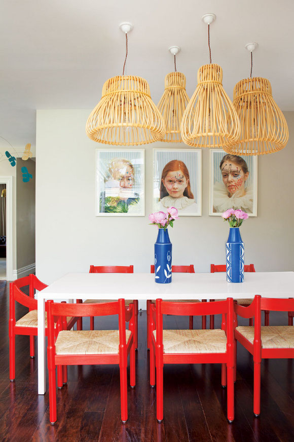 Red chairs with rattan seat and pendant lamps