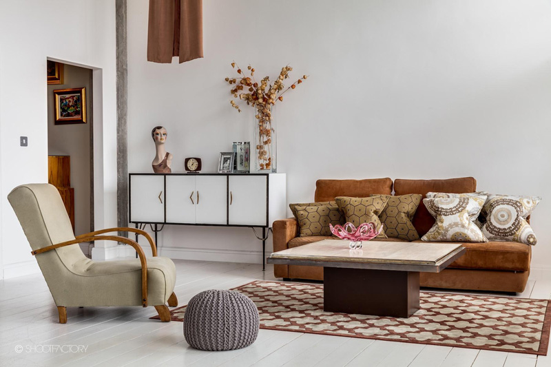 Simple Living Room Decor With A Brown Leather Couch
