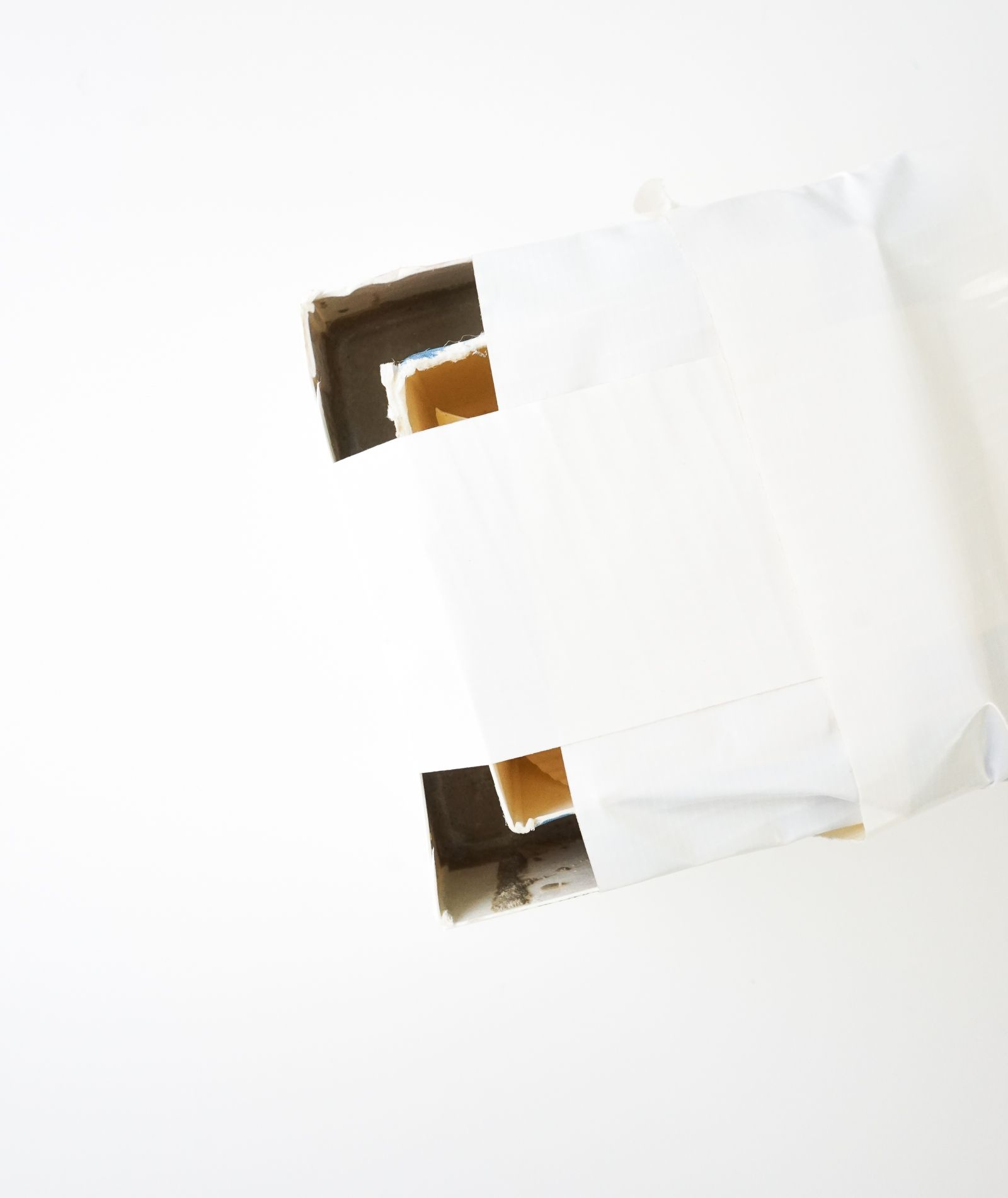 Tape the smaller carton