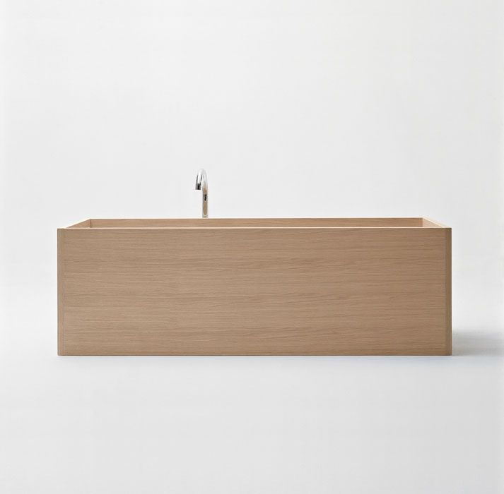 Even in this rectangular wooden bathtub by Unique Wood Design, the light wood and spare style evoke an Asian esthetic.