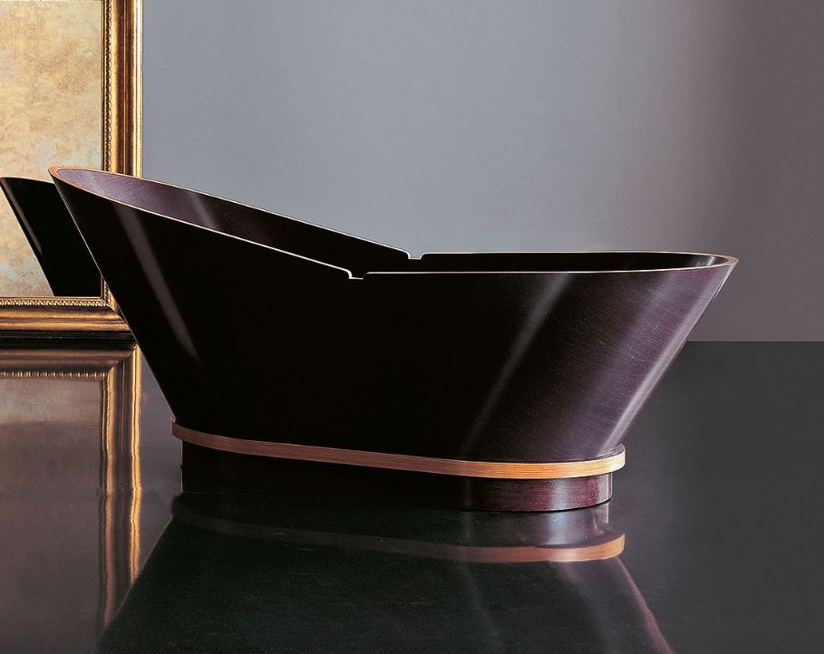 This wooden bathtub by Gruppo Treese is made from marine plywood. Called the Capyso, it is available in cherry or wenge, is a definitely of a modern, western shape.