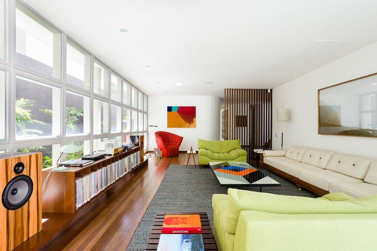 AA House indoor social area with armchairs