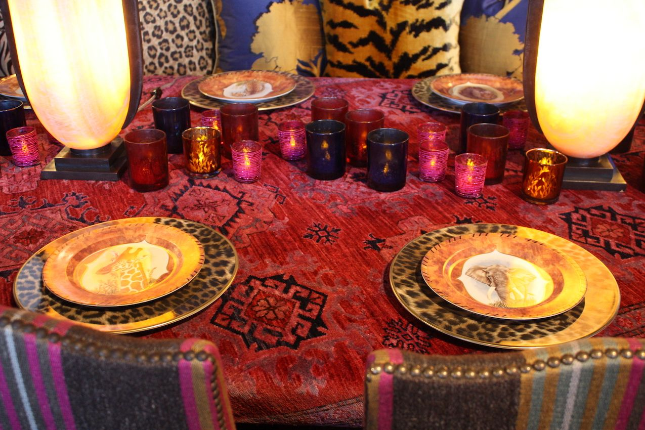 Animal print and gilded dinnerware adds to the exotic feel, while the collection of multicolored votives is a simple but effective firing its the taller lights.