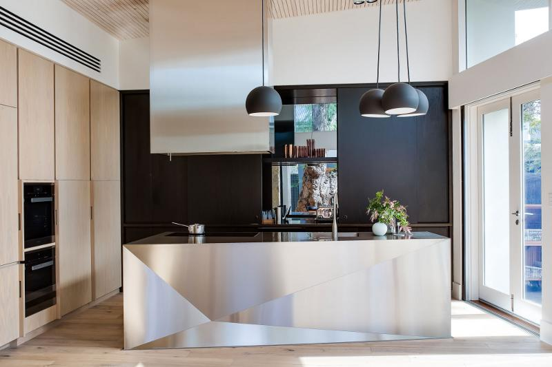 Black pendant lamps over kitchen island
