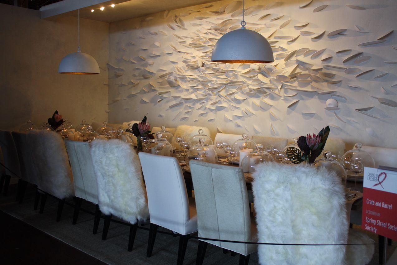 Crate and Barrel reinterpreted a fragmented-plates installation on the wall with a white tablescape.