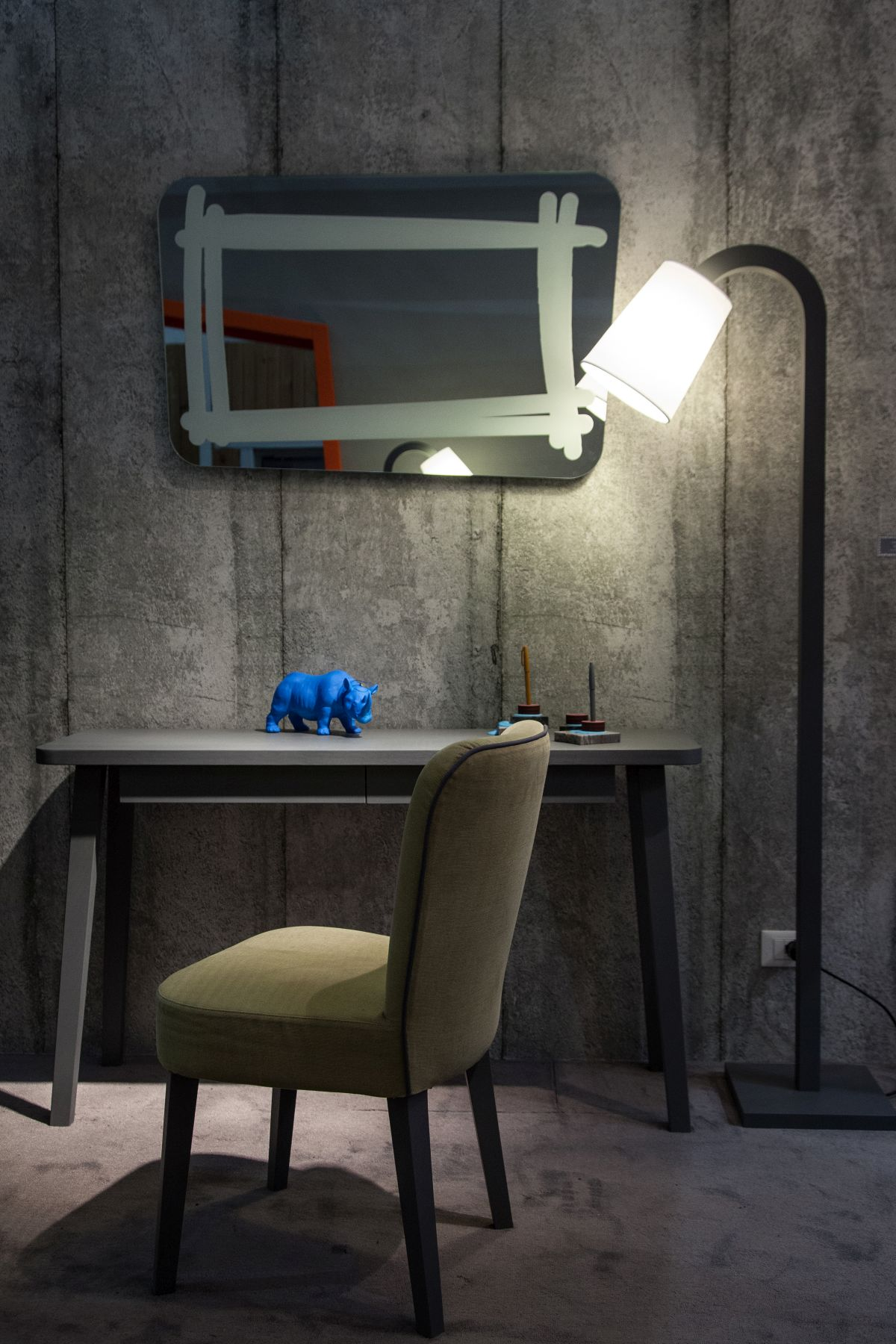 Desk area with floor lamp and mirror