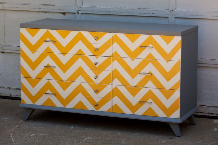 Dresser-chest with a chevron pattern