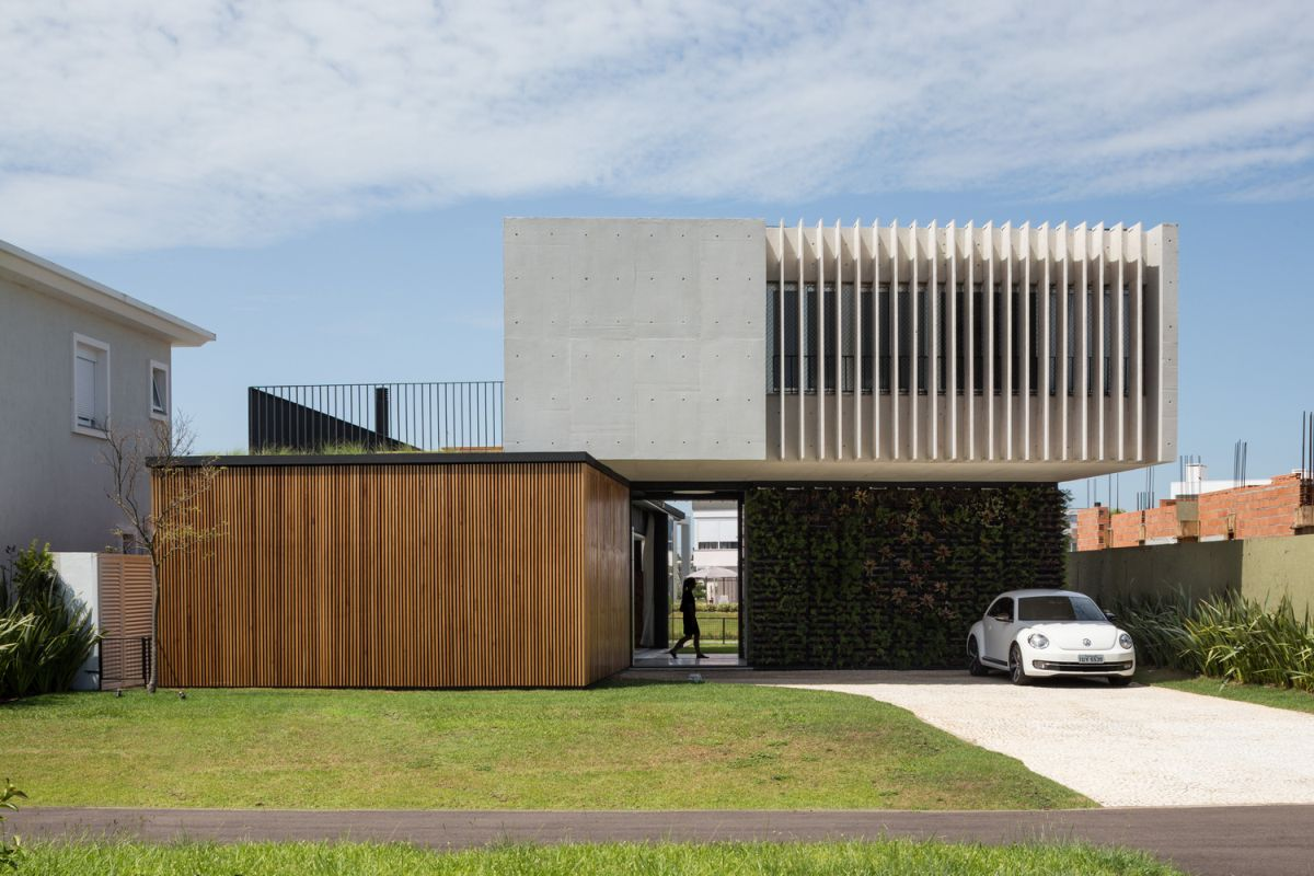Enseada House in Brazil back facade parking area